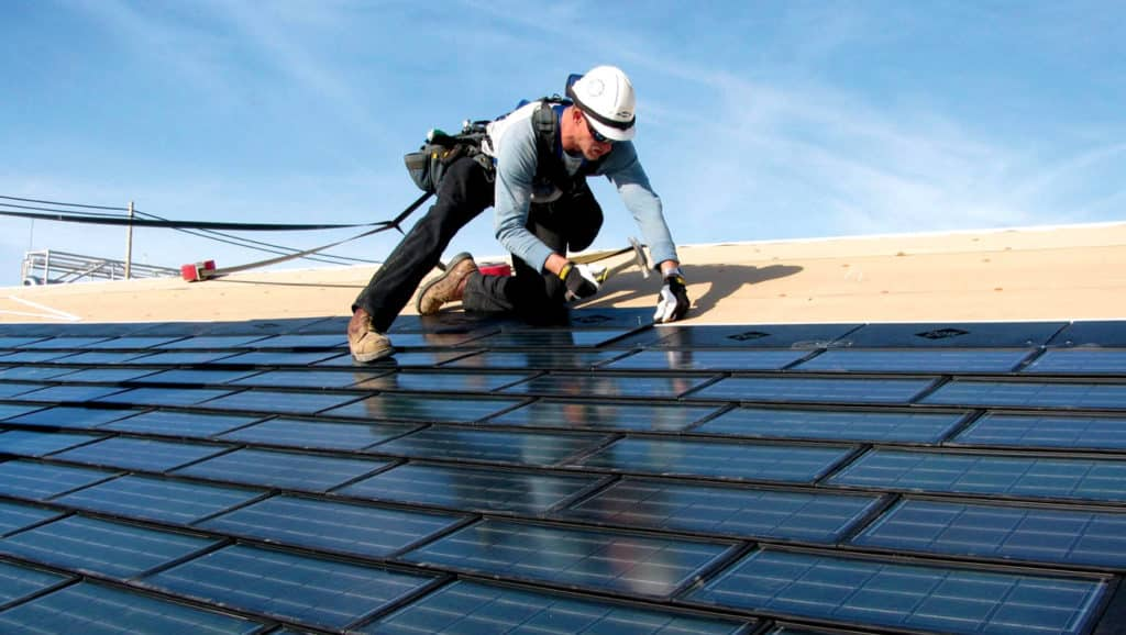 Person-Installing-A-Solar-Shingle