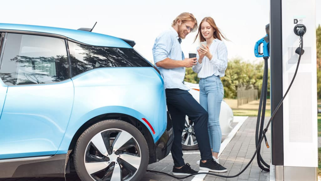 Couple-Standing-Next-To-The-Car